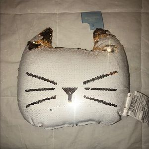 Reverse sequin cat pillow gold and white.